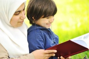 7992910-mother-muslim-and-her-son-in-the-nature-reading-together